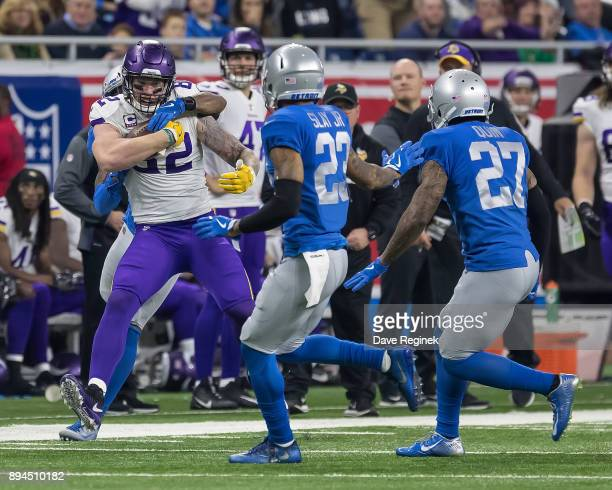 Kyle Rudolph of the Minnesota Vikings runs with the football against the Detroit Lions during an NFL game at Ford Field on November 23 2016 in...