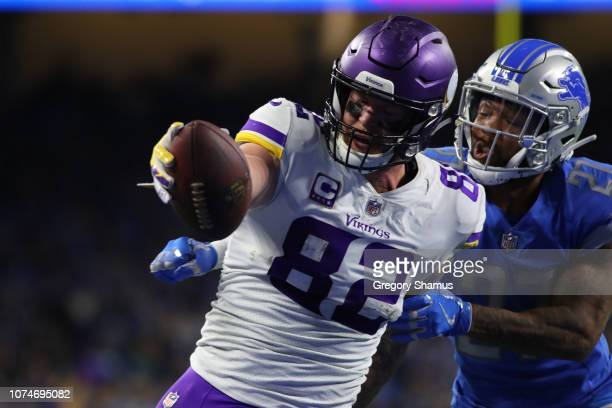 Kyle Rudolph of the Minnesota Vikings scores a touch down in front of Glover Quin of the Detroit Lions in the fourth quarter at Ford Field on...