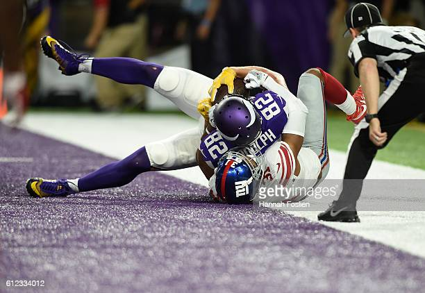 Kyle Rudolph of the Minnesota Vikings scores a touchdown in the second quarter of the game against the New York Giants on October 3 2016 at US Bank...