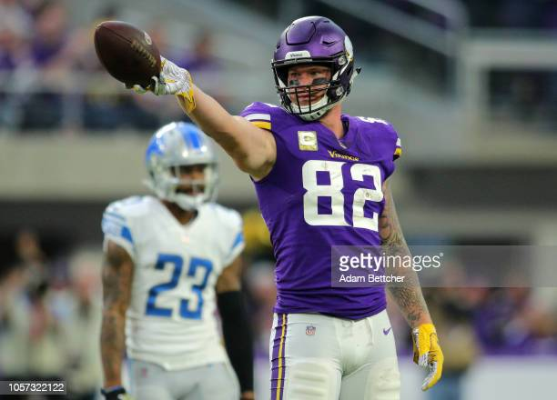 Kyle Rudolph of the Minnesota Vikings signals for a first down in the fourth quarter of the game against the Detroit Lions at US Bank Stadium on...