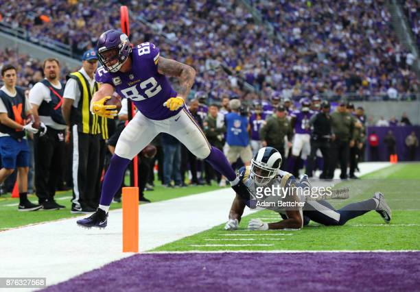 Kyle Rudolph of the Minnesota Vikings stretches the ball out for a first down at the end of the third quarter of the game against the Los Angeles...
