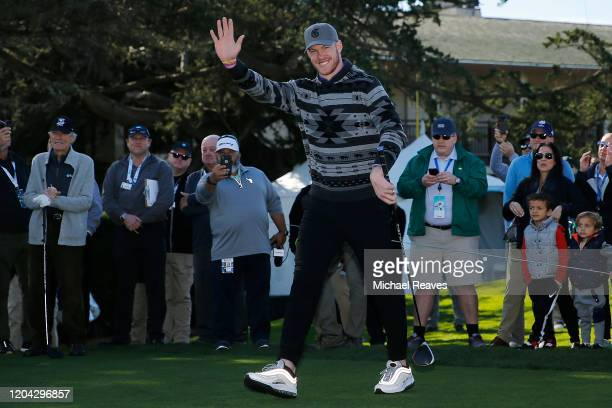 Kyle Rudolph of the Minnesota Vikings waves to the crowd prior to the 3M Celebrity Challenge prior to the ATT Pebble Beach ProAm at Pebble Beach Golf...