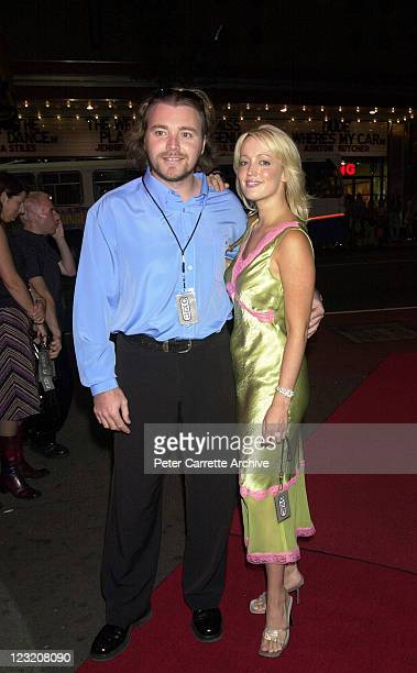 Kyle Sandilands and Jackie O arrive for the debut single launch by the pop group Scandal'Us at Planet Hollywood on April 08 2001 in Sydney Australia