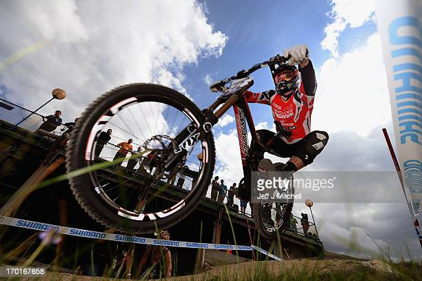 Kyle Sangers of Canada competes in the men's downhill qualifying round at the UCI Mountain Bike World Cup on June 8 2013 in Fort WilliamScotland
