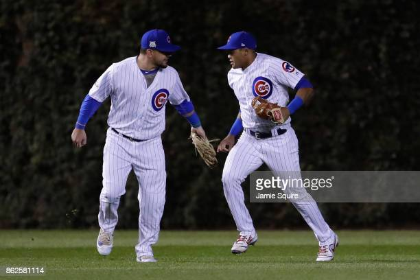 Kyle Schwarber and Addison Russell of the Chicago Cubs celebrate after Russell made a catch in the fourth inning against the Los Angeles Dodgers...