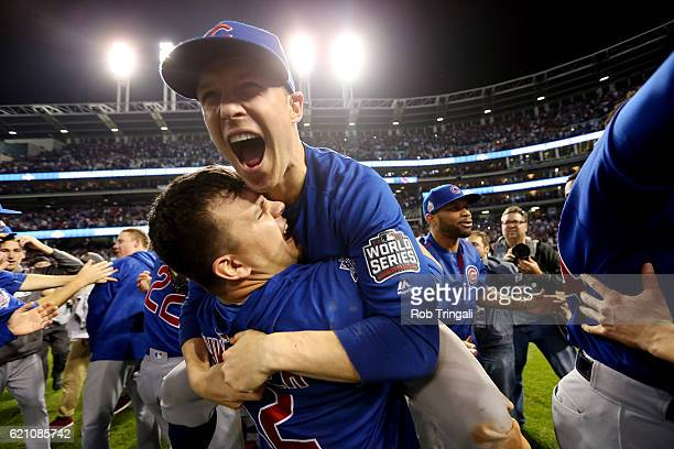 Kyle Schwarber and Chris Coghlan of the Chicago Cubs celebrate on the field after defeating the Cleveland Indians in Game 7 of the 2016 World Series...