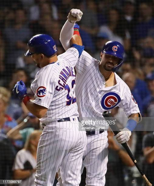 Kyle Schwarber and Nicholas Castellanos of the Chicago Cubs celebrate Schwarber's solo home run in the 7th inning against the Seattle Mariners at...