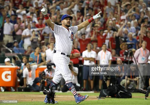 Kyle Schwarber of the Chicago Cubs and National League celebrates in the semifinals during the TMobile Home Run Derby at Nationals Park on July 16...