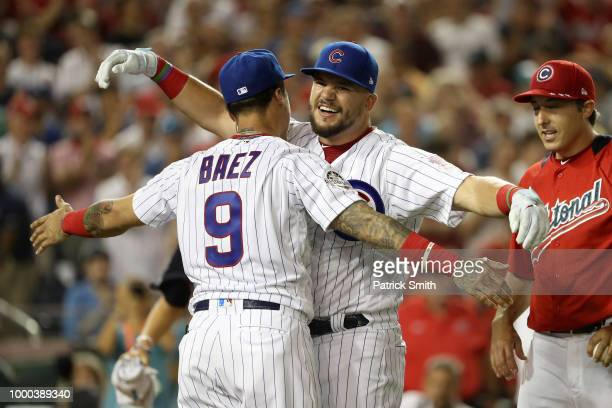 Kyle Schwarber of the Chicago Cubs and National League celebrates with Javier Baez of the Chicago Cubs in the semifinals during the TMobile Home Run...
