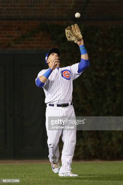 Kyle Schwarber of the Chicago Cubs catches a fly ball in the third inning against the Los Angeles Dodgers during game four of the National League...
