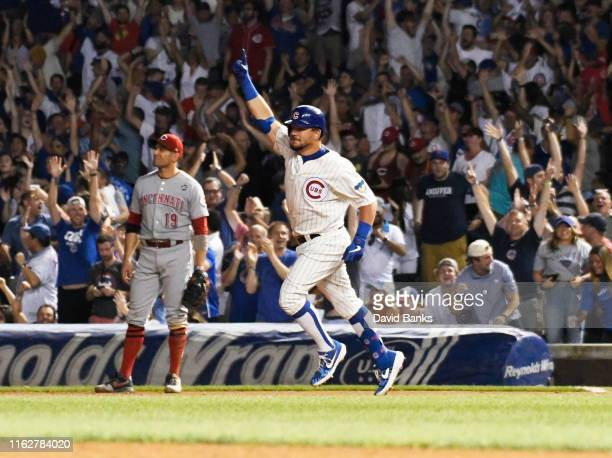Kyle Schwarber of the Chicago Cubs celebrates his walk off home run against the Cincinnati Reds during the tenth inning at Wrigley Field on July 16,...