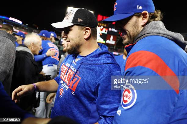 Kyle Schwarber of the Chicago Cubs celebrates on the field after winning Game 5 of the National League Division Series against the Washington...
