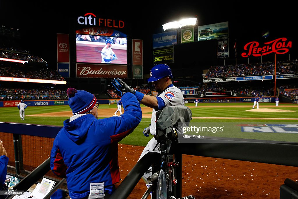 Kyle Schwarber #12 of the Chicago Cubs celebrates with his teammates in the dugout after hitting a solo home run in the eighth inning against Matt Harvey #33 of the New York Mets during game one of the 2015 MLB National League Championship Series at Citi Field on October 17, 2015 in the Flushing neighborhood of the Queens borough of New York City.
