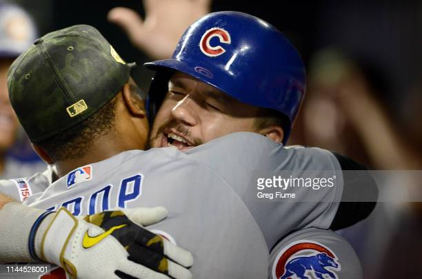 Kyle Schwarber of the Chicago Cubs celebrates with Pedro Strop after hitting a tworun home run in the eighth inning against the Washington Nationals...