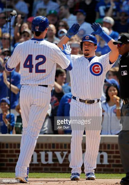 Kyle Schwarber of the Chicago Cubs congratulates Kris Bryant after his two run home run against the Pittsburgh Pirates during the first inning at...