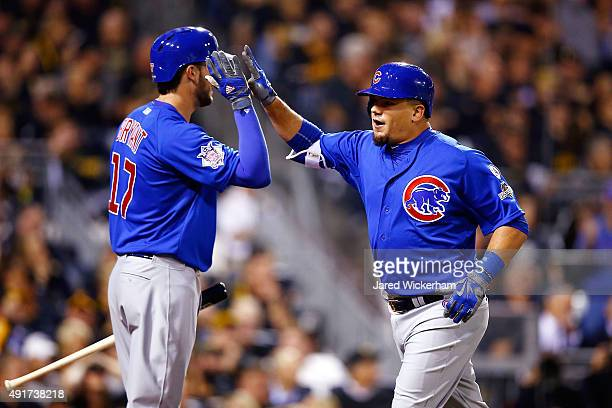 Kyle Schwarber of the Chicago Cubs high fives Kris Bryant of the Chicago Cubs after hitting a tworun home run in the third inning during the National...