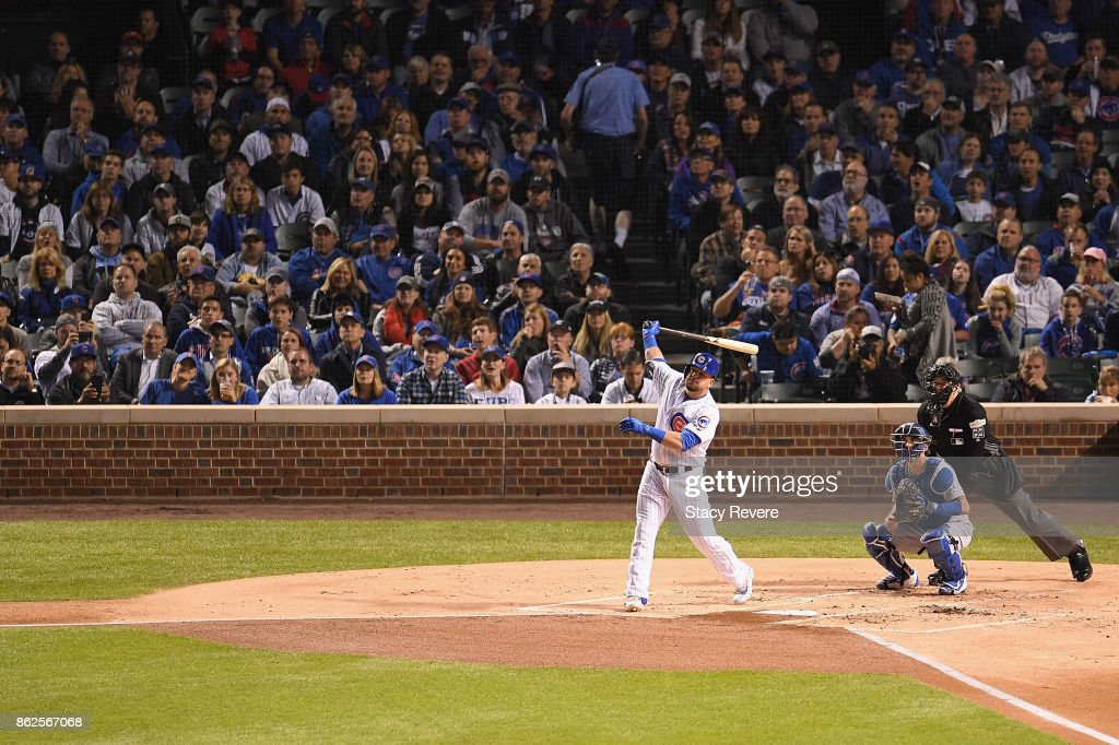 Kyle Schwarber #12 of the Chicago Cubs hits a home run in the first inning against the Los Angeles Dodgers during game three of the National League Championship Series at Wrigley Field on October 17, 2017 in Chicago, Illinois.