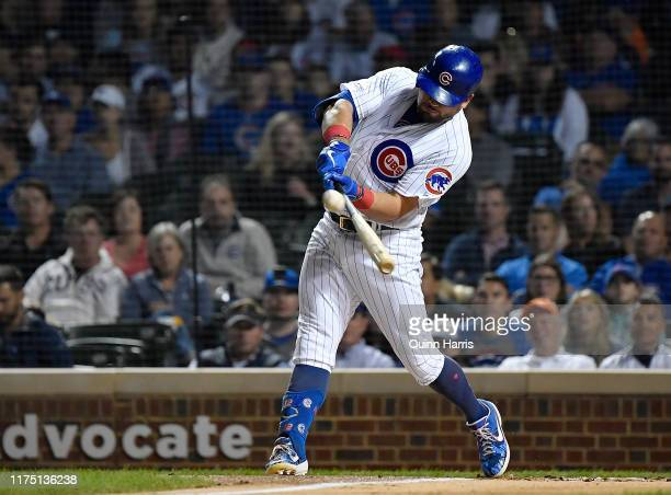 Kyle Schwarber of the Chicago Cubs hits a three run home run in the first inning against the Cincinnati Reds at Wrigley Field on September 16 2019 in...