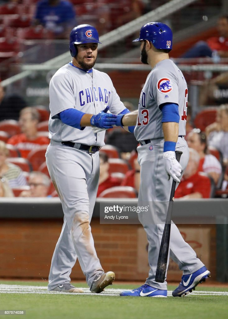 Kyle Schwarber #12 of the Chicago Cubs is congratulated after scoring in the 8th inning by Alex Avila#13 against the Cincinnati Reds at Great American Ball Park on August 22, 2017 in Cincinnati, Ohio.