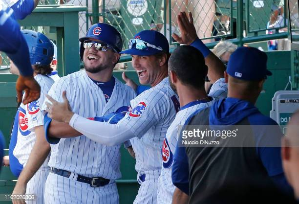 Kyle Schwarber of the Chicago Cubs is congratulated by Albert Almora Jr. #5 following his solo home run during the sixth inning against the...