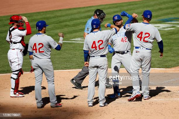 Kyle Schwarber of the Chicago Cubs is congratulated by Anthony Rizzo, /David Bote and Javier Baez after driving them home on a grand slam during the...