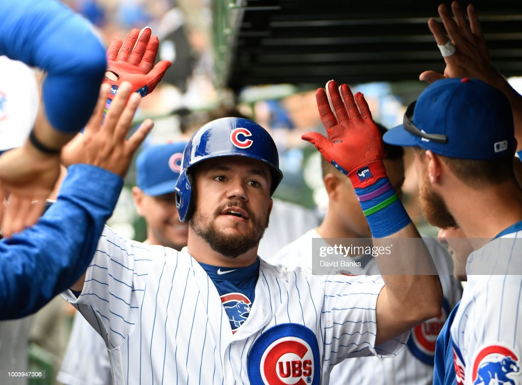 Kyle Schwarber #12 of the Chicago Cubs is greeted after hitting a home run against theSt. Louis Cardinals during the sixth inning on July 22, 2018 at Wrigley Field in Chicago, Illinois.