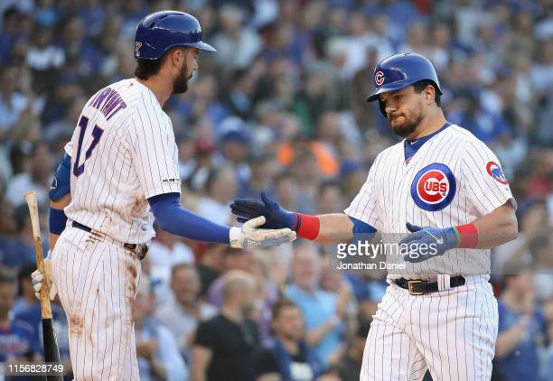 Kyle Schwarber of the Chicago Cubs is greeted by Kris Bryant after hitting a first pitch, solo home run in the 1st inning against the Chicago White...