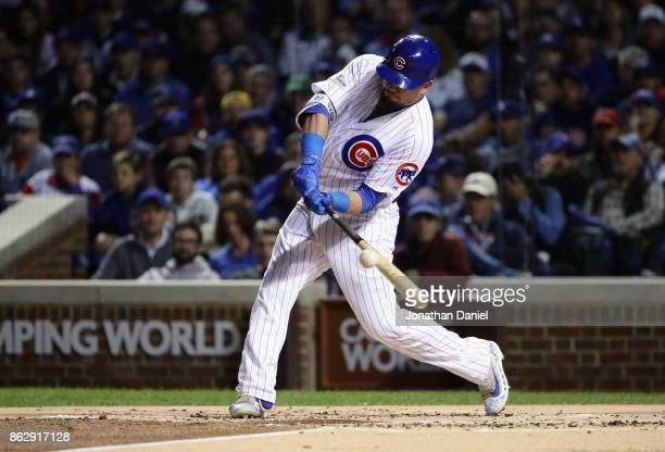 Kyle Schwarber of the Chicago Cubs lines out in the first inning against the Los Angeles Dodgers during game four of the National League Championship...