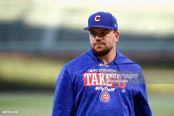 Kyle Schwarber of the Chicago Cubs looks on before game three of the National League Championship Series against the Los Angeles Dodgers at Wrigley...