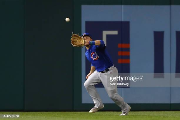 Kyle Schwarber of the Chicago Cubs makes a catch during Game 1 of the National League Division Series against the Washington Nationals at Nationals...