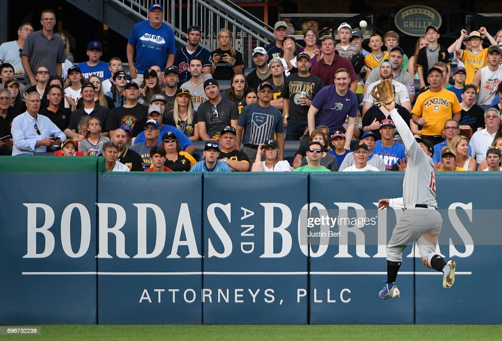 Kyle Schwarber #12 of the Chicago Cubs makes a leaping catch on a ball off the bat of Jordy Mercer #10 of the Pittsburgh Pirates in the third inning during the game at PNC Park on June 16, 2017 in Pittsburgh, Pennsylvania. In honor of African American Heritage Night, both teams are wearing throwback uniforms from the Negro League.