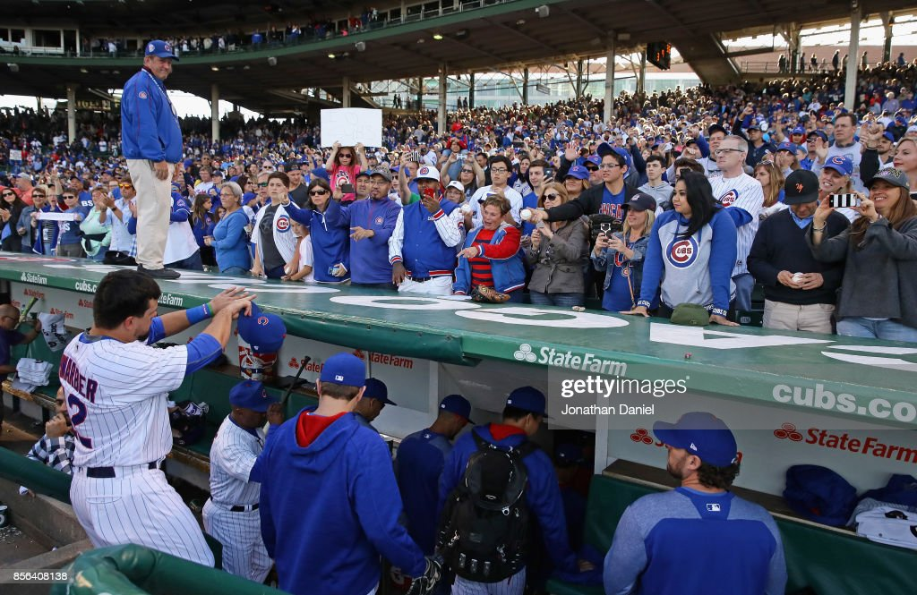 Kyle Schwarber #12 of the Chicago Cubs points to the fans as he leaves the field after the last regular season game against the Cincinnati Reds at Wrigley Field on October 1, 2017 in Chicago, Illinois. The Reds defeated the Cubs 3-1.