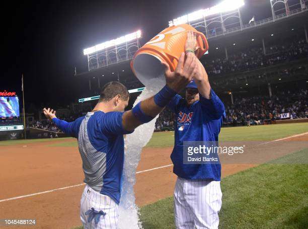 Kyle Schwarber of the Chicago Cubs pours gatorade on Albert Almora Jr of the Chicago Cubs after his gamewinning walkoff single against the Pittsburgh...