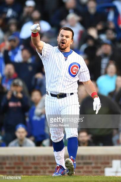 Kyle Schwarber of the Chicago Cubs reacts after being called out by the third base umpire during the ninth inning of a game against the Los Angeles...