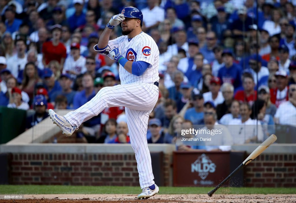 Kyle Schwarber #12 of the Chicago Cubs reacts after being called out on strikes in the second inning against the Washington Nationals during game three of the National League Division Series at Wrigley Field on October 9, 2017 in Chicago, Illinois.