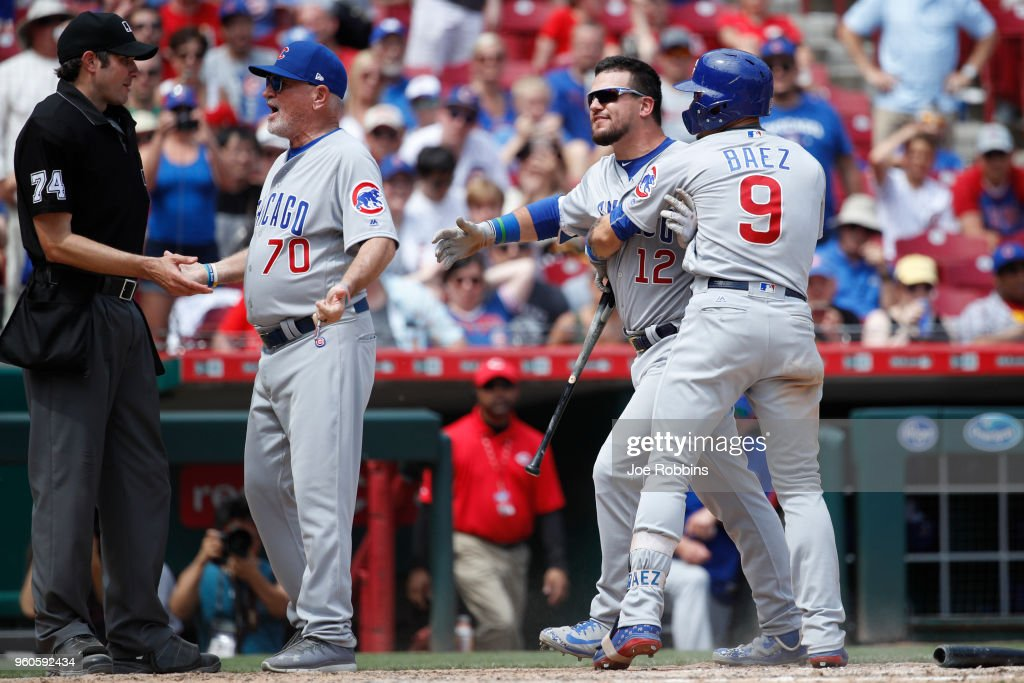 Kyle Schwarber #12 of the Chicago Cubs reacts after being ejected by umpire John Tumpane for arguing balls and strikes in the seventh inning against the Cincinnati Reds at Great American Ball Park on May 20, 2018 in Cincinnati, Ohio. The Cubs won 6-1.