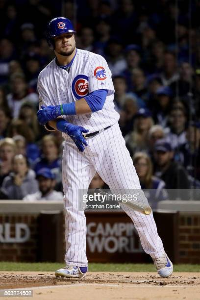 Kyle Schwarber of the Chicago Cubs reacts after drawing a walk in the first inning against the Los Angeles Dodgers during game five of the National...