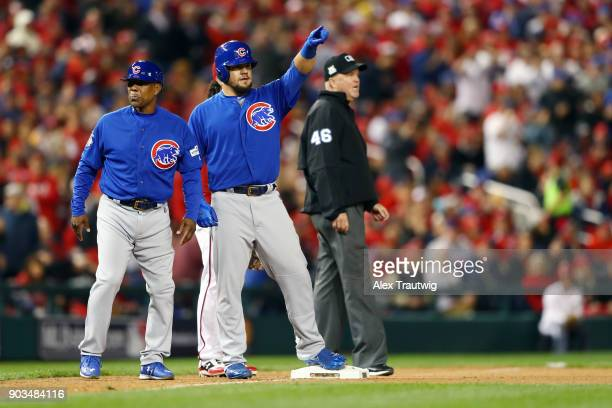 Kyle Schwarber of the Chicago Cubs reacts after reaching third base during Game 5 of the National League Division Series against the Washington...