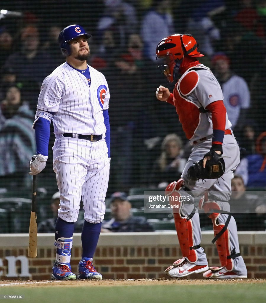 Kyle Schwarber #12 of the Chicago Cubs reacts after striking out to end the game as Yadier Molina #4 of the St. Louis Cardinals celebrates at Wrigley Field on April 17, 2018 in Chicago, Illinois. The Cardinals defeated the Cubs 5-3.