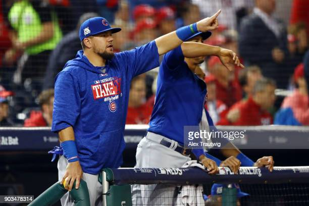 Kyle Schwarber of the Chicago Cubs reacts from the dugout during Game 5 of the National League Division Series against the Washington Nationals at...