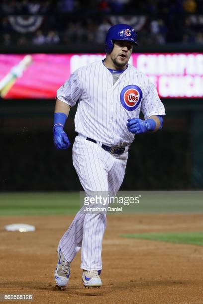 Kyle Schwarber of the Chicago Cubs rounds the bases after hitting a home run in the first inning against the Los Angeles Dodgers during game three of...