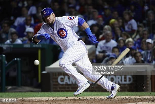 Kyle Schwarber of the Chicago Cubs runs after bunting in the sixth inning against the Los Angeles Dodgers during game five of the National League...