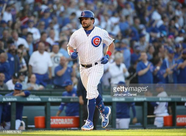Kyle Schwarber of the Chicago Cubs (runs the bases after hitting a first pitch, solo home run in the 1st inning against the Chicago White Sox at...