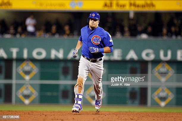 Kyle Schwarber of the Chicago Cubs runs the bases after hitting a tworun home run in the third inning during the National League Wild Card game...