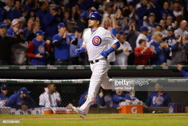Kyle Schwarber of the Chicago Cubs runs the bases after hitting a solo home run in the first inning against the Los Angeles Dodgers during game three...