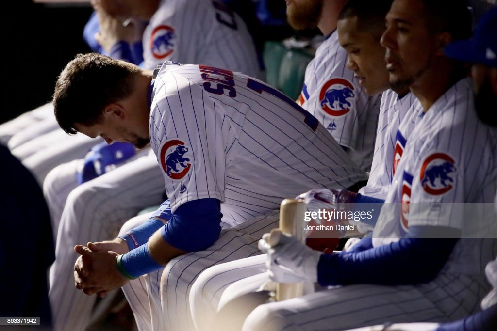 Kyle Schwarber #12 of the Chicago Cubs sits in the dugout in the ninth inning against the Los Angeles Dodgers during game five of the National League Championship Series at Wrigley Field on October 19, 2017 in Chicago, Illinois.