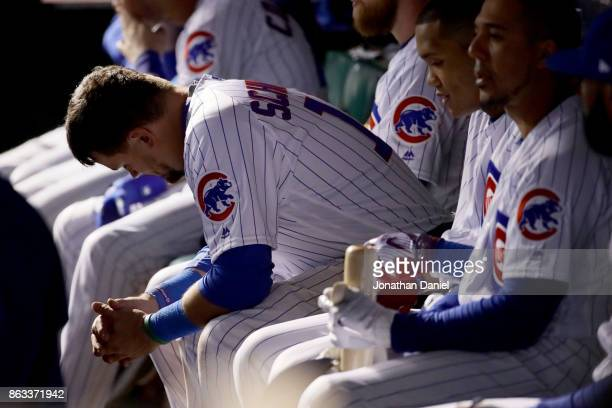 Kyle Schwarber of the Chicago Cubs sits in the dugout in the ninth inning against the Los Angeles Dodgers during game five of the National League...