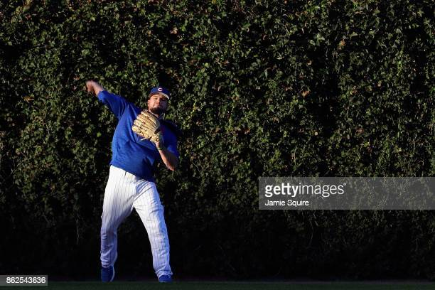 Kyle Schwarber of the Chicago Cubs warms up before game three of the National League Championship Series against the Los Angeles Dodgers at Wrigley...