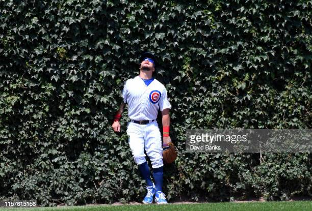 Kyle Schwarber of the Chicago Cubs watches a two run home run by Todd Frazier of the New York Mets during the third inning at Wrigley Field on June...