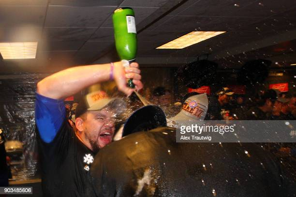 Kyle Schwarber sprays Kris Bryant of the Chicago Cubs with champagne in the clubhouse after winning Game 5 of the National League Division Series 98...